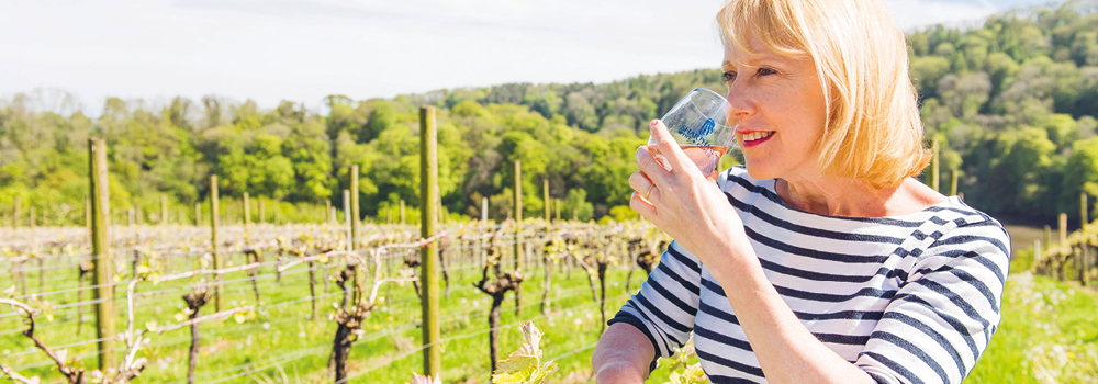 Wine critic, Susy Atkins,tasting wine at a vineyard
