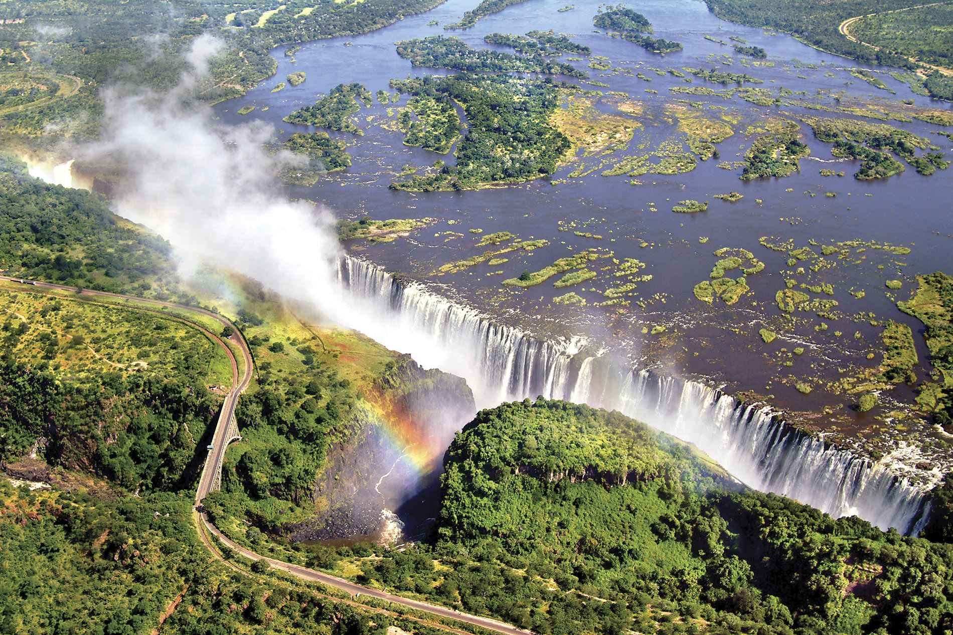 a large waterfall over some water with Victoria Falls in the background