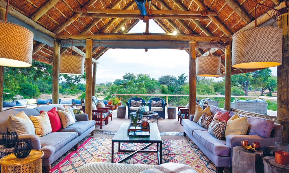 A lounge looking out onto a game reserve